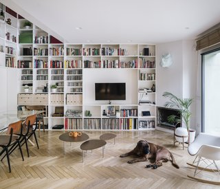 Given the home's tight and efficient footprint, the architects sought to use simple materials and strategic moves to delineate different spaces and uses. The lower ceiling height of the living room, for example, distinguishes it from the dining area, which has a taller ceiling.