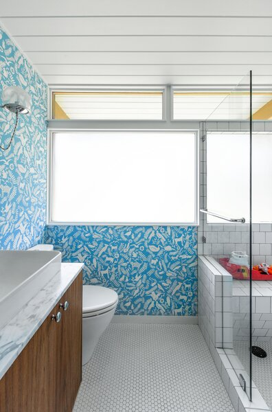 """""""Kasey and Nick brought their own voice through some of the specific interior finishes, such as the flooring in the mudroom and the wonderful wallpaper in the kids' bathroom,"""" explains Hutchison."""