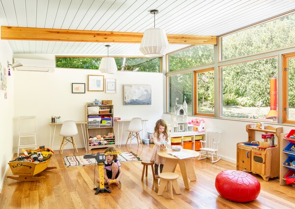 The expanded west end followed the existing layout and incorporated similar wood windows found elsewhere in the home. The children's bedrooms now have direct access to the light-filled playroom, which opens to the front yard.