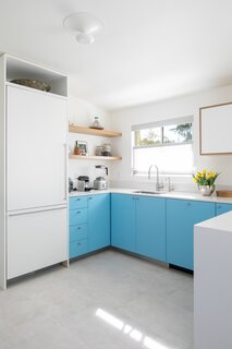 """""""We had all white cabinets in our NY kitchen and wanted to try something different and more colorful here,"""
