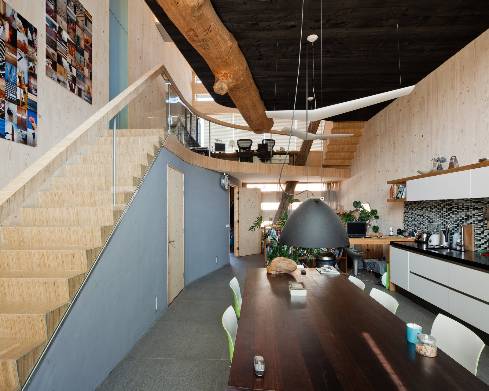 The dining and kitchen area are located on the first floor. The ceramic tile floor is from a local source, which is Cradle to Cradle certified.  Energy Neutral House