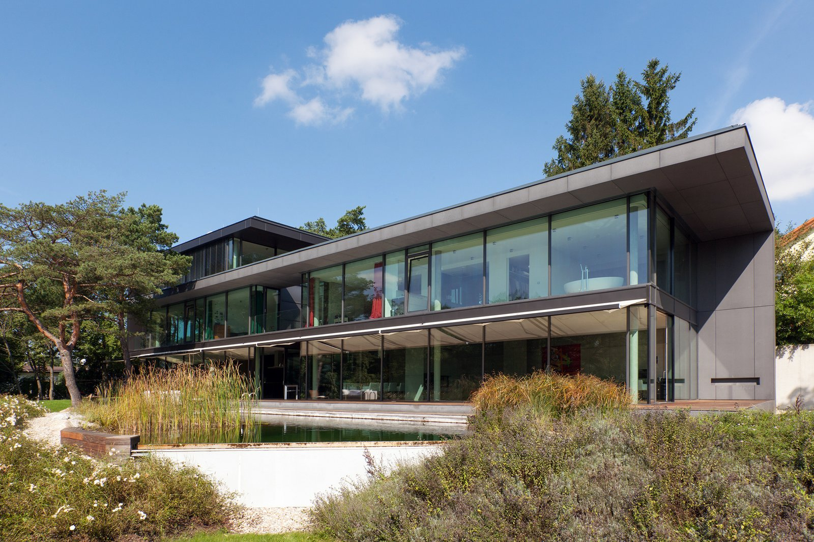 View from the garden on the living area, over the pond  Black Pearl by Architect Zoran Bodrozic