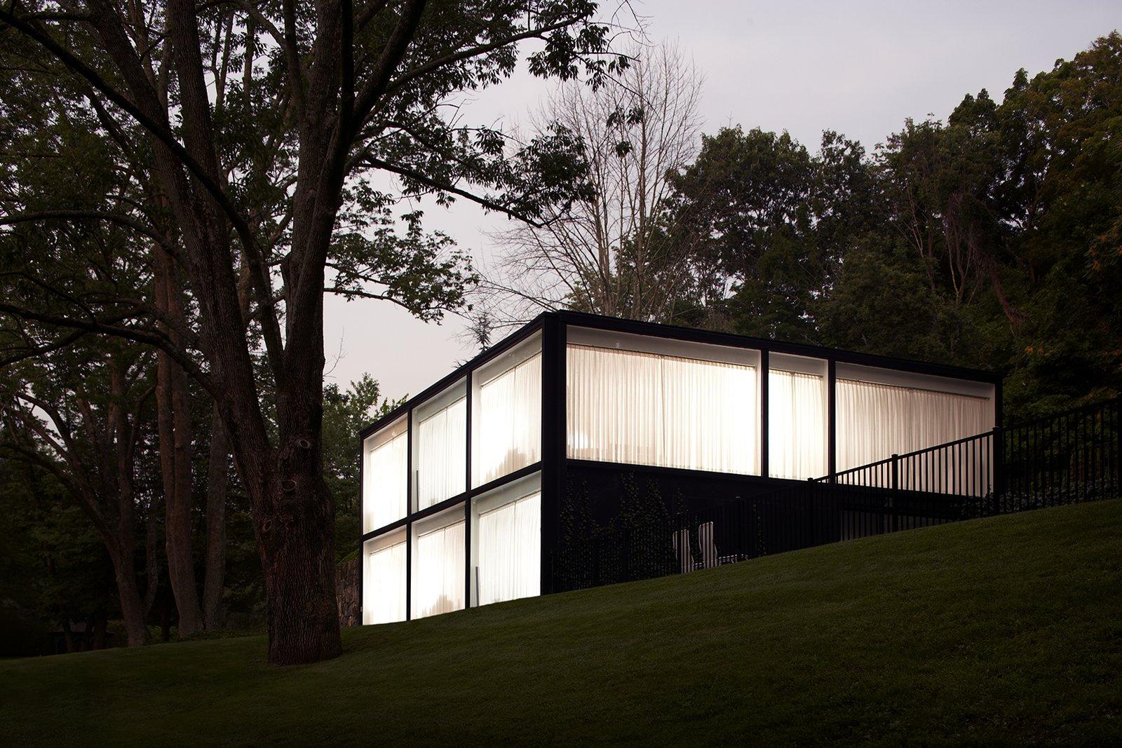 Exterior at dusk.  Glass House