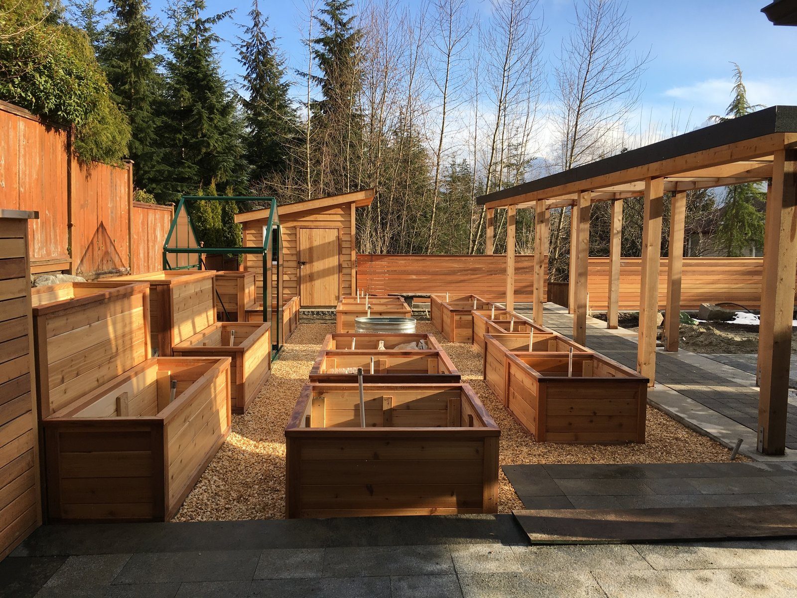 """Overlooking the """"growzone"""" with raised cedar planter boxes, greenhouse & potting shed next to the pergola  20+ Ways to Design with Planters by Allie Weiss"""