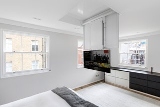 Motorised TV lift in the master bedroom