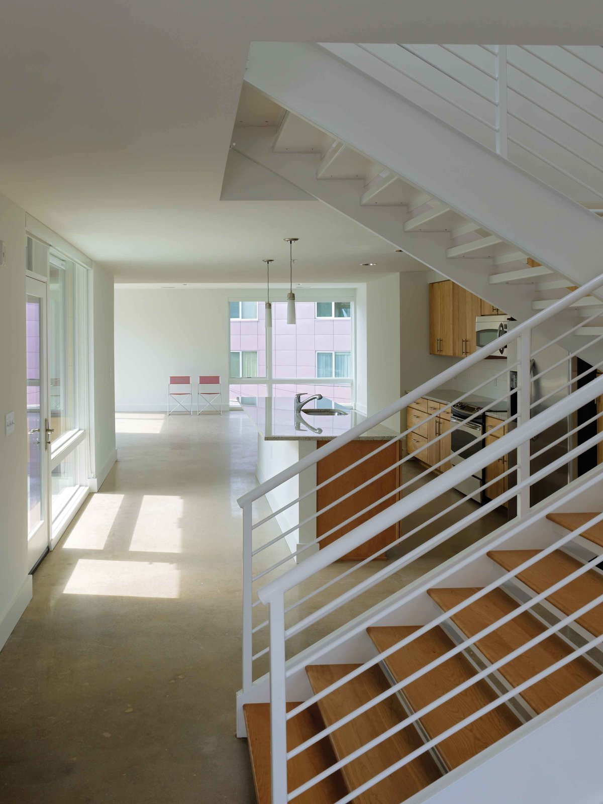 Two story units  In Living Color by Suzane Reatig Architecture