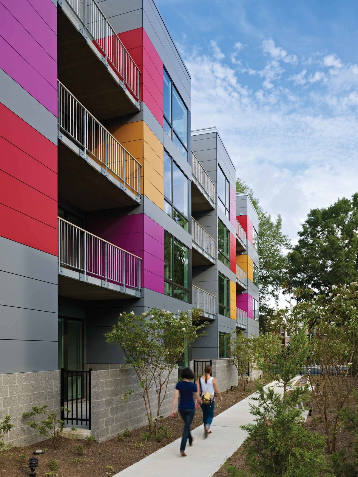 Garden pathway and private balconies  In Living Color by Suzane Reatig Architecture
