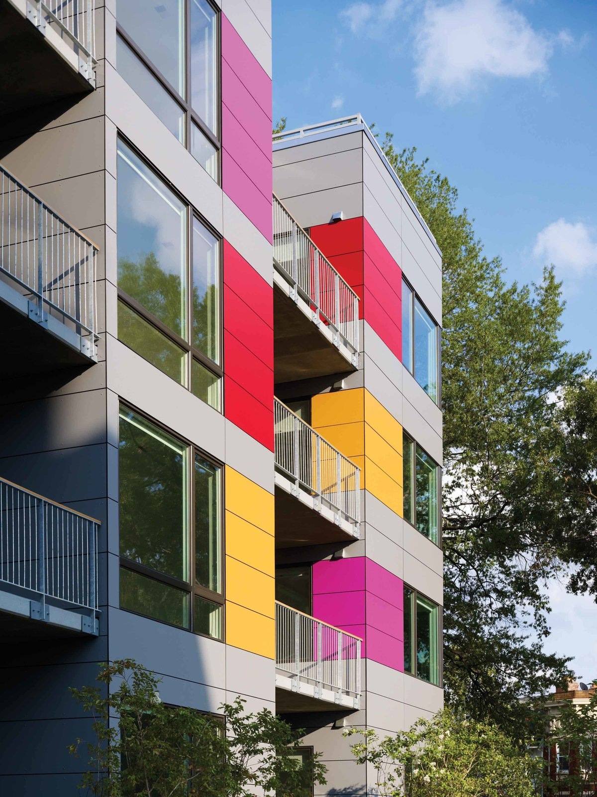 Colorful Trespa rainscreen on west facade  In Living Color by Suzane Reatig Architecture
