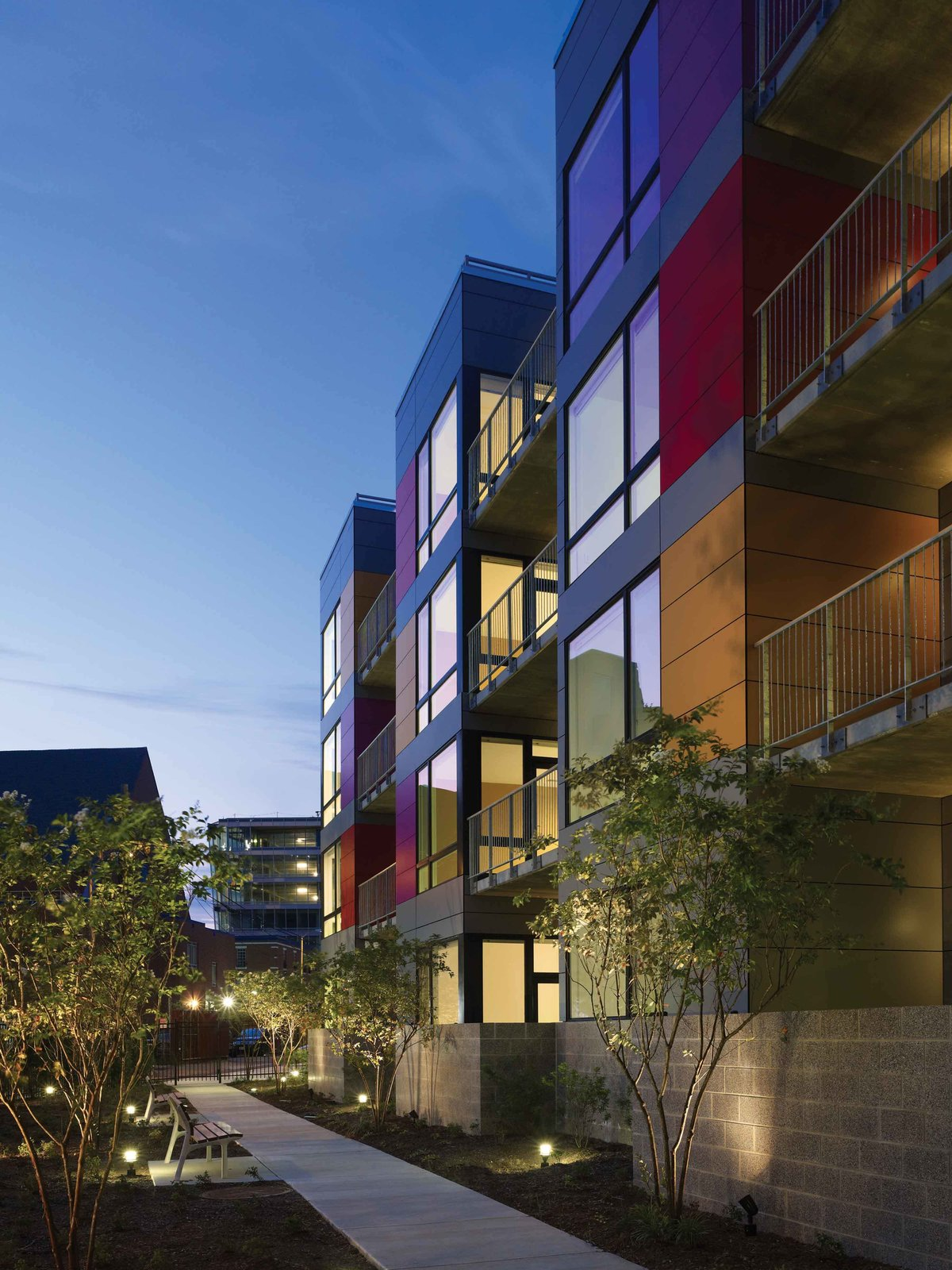 West facade garden pathway at dusk  In Living Color by Suzane Reatig Architecture