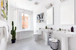 A sunny full bathroom is also located on the top level. Many of the same finishes are pull through from the master bathroom, including marble floors and nickel plated finishes.