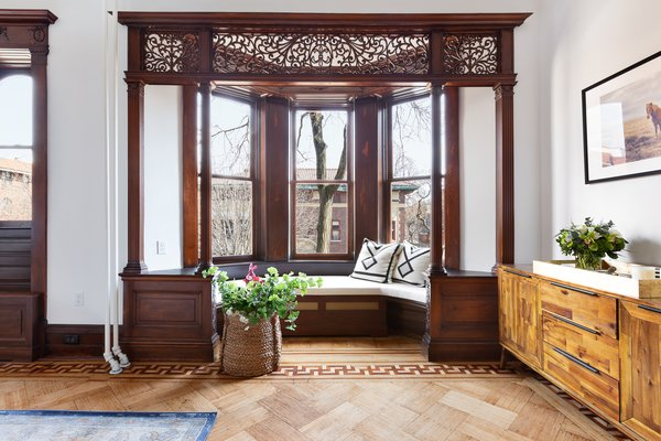 """""""The window benches in the master bedroom are a particular favorite of mine. The original woodwork in this house is definitely the star of the show,"""" said designer Adam Dahill."""