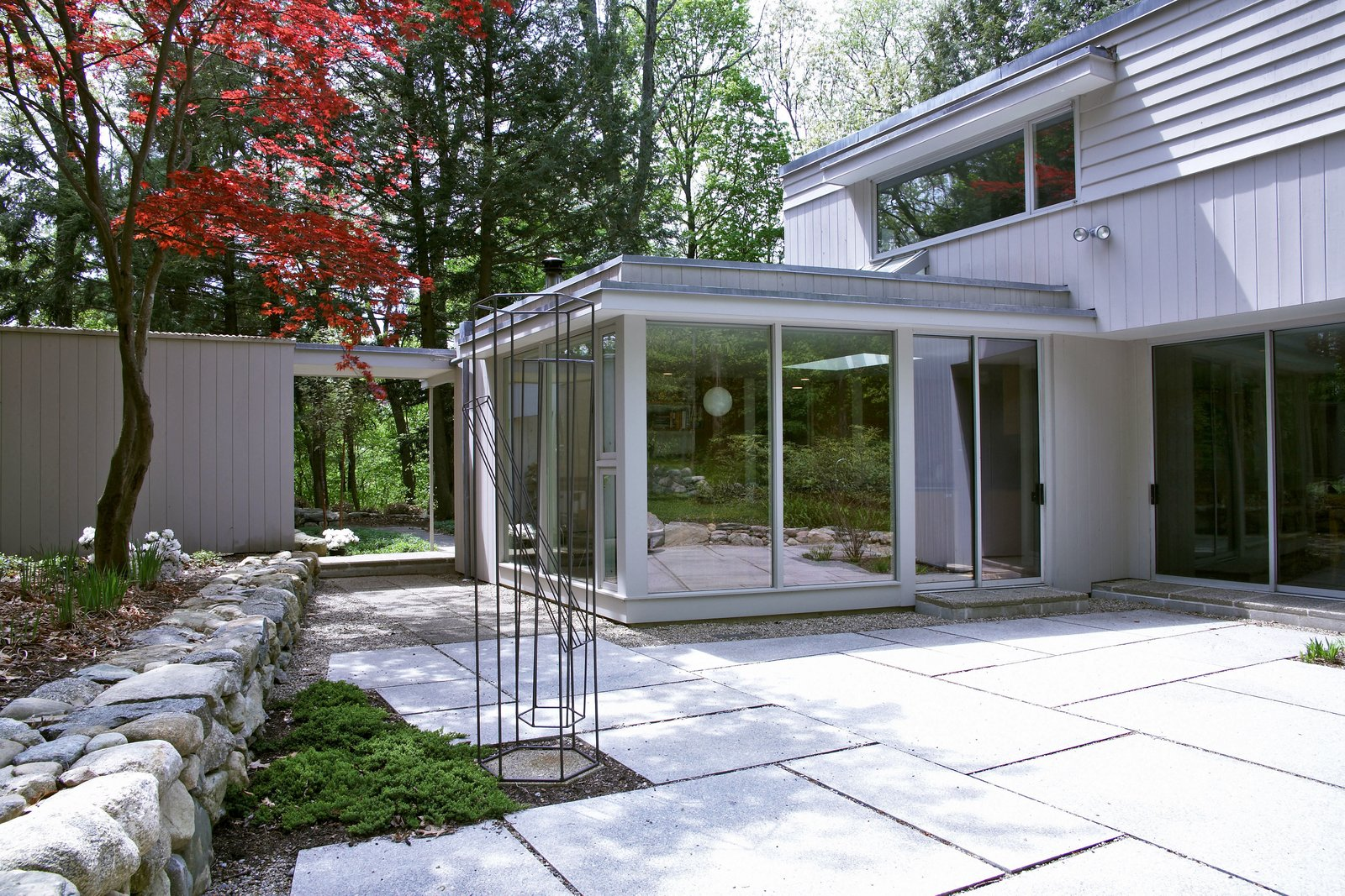 The new addition alongside the redesigned patio and garden.  Giese House by Wolf Architects, Inc.