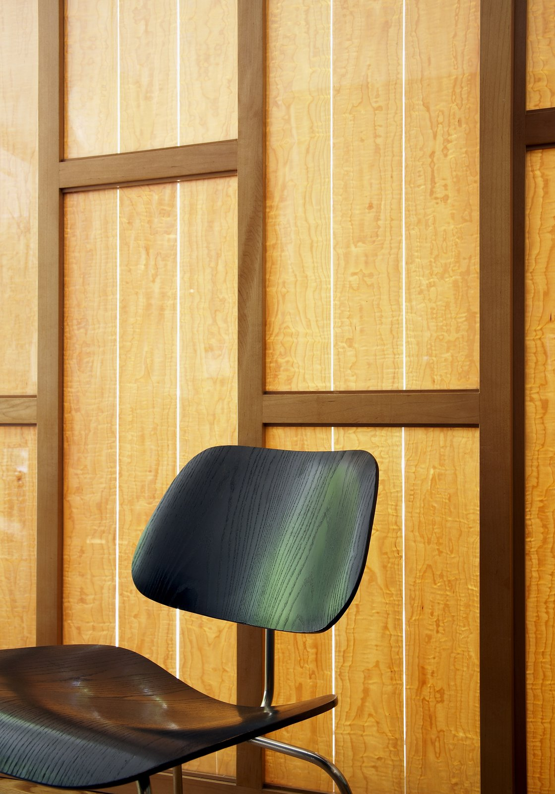 Eames' chair in front of our custom sunscreen with maple veneer.  Giese House by Wolf Architects, Inc.