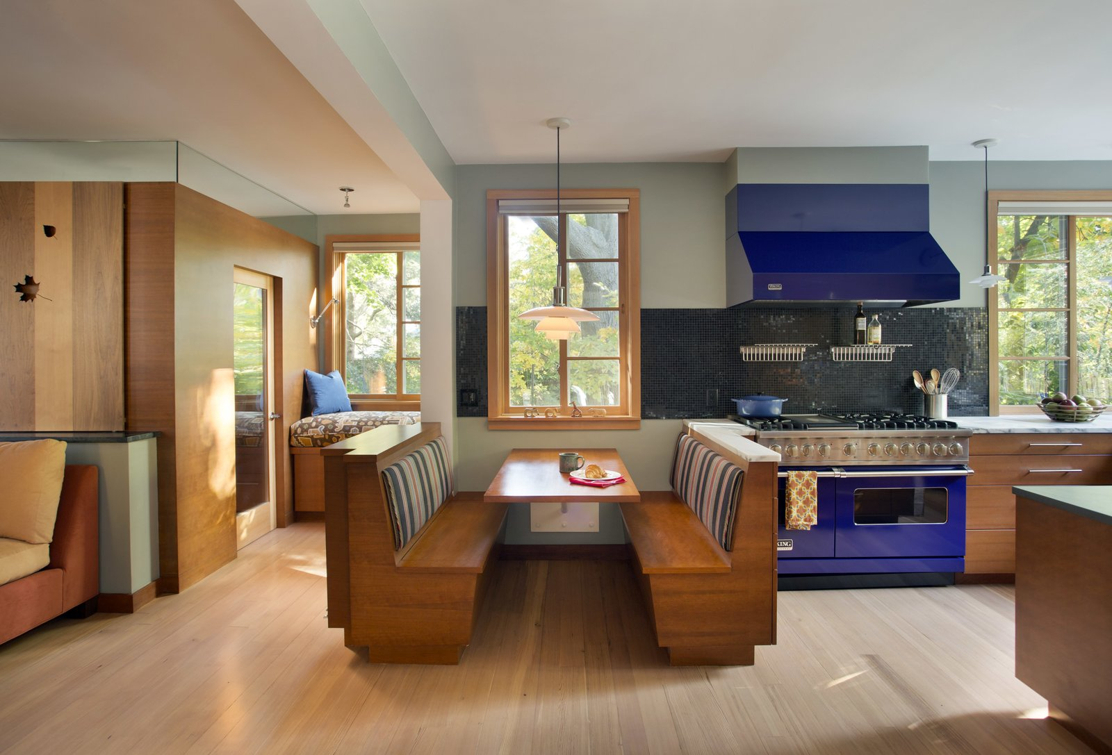 A dining nook in the kitchen, with wife's office at the left.  Sustainable Urban Villa by Wolf Architects, Inc.