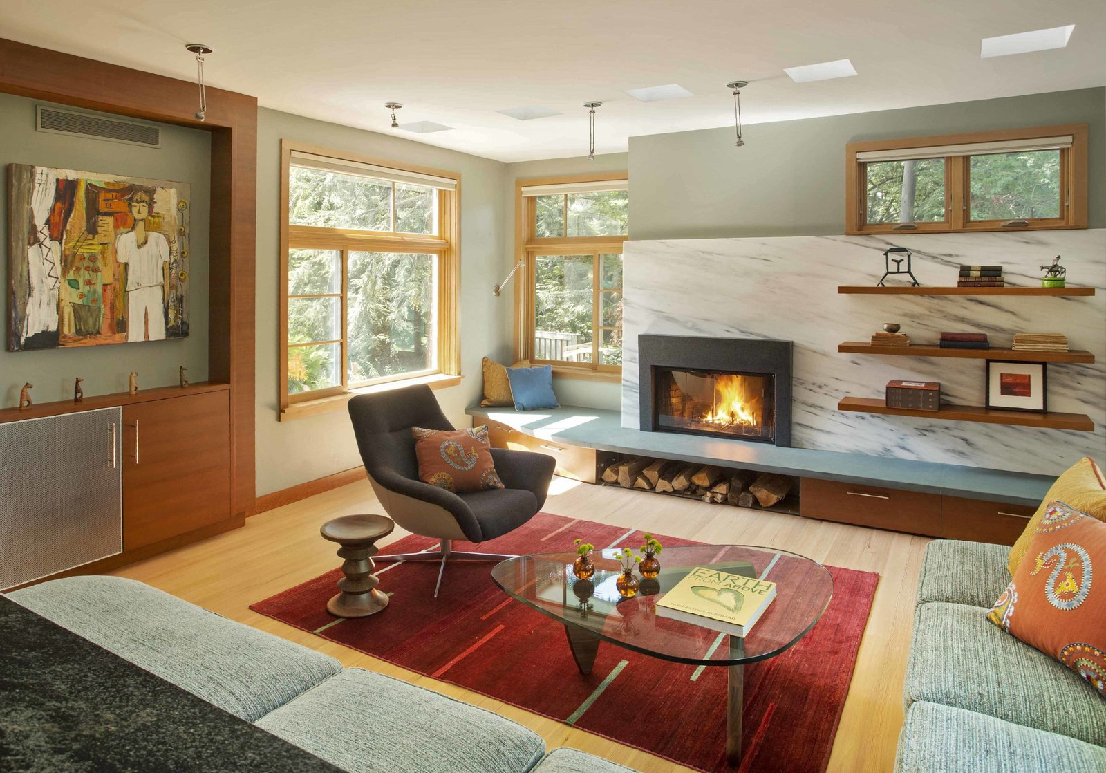 The living room, with a Vermont marble slab at the fireplace wall.  Sustainable Urban Villa by Wolf Architects, Inc.
