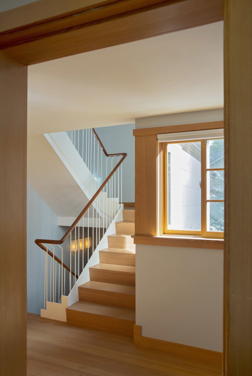 The stair at the second floor, leading up to the husband's office at the third floor.  Sustainable Urban Villa by Wolf Architects, Inc.