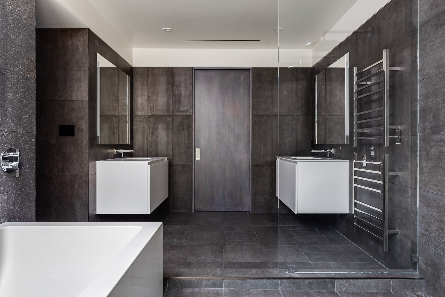 Bath Room, Undermount Sink, Freestanding Tub, Soaking Tub, Cement Tile Floor, Open Shower, and Ceiling Lighting Master Bathroom - White thermafoil floating vanities, Duravit and Hansgrohe fixtures, Large-format Italian porcelain tile from Emil Ceramica  Castro Residence by Diego Pacheco Design Practice