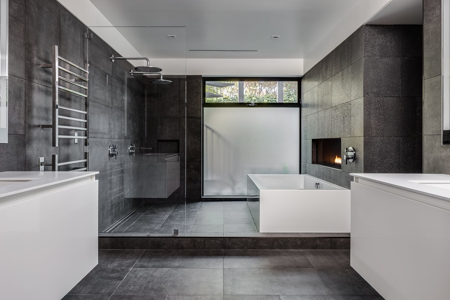 Bath, Porcelain Tile, Drop In, Soaking, Open, Recessed, and Porcelain Tile Master Bathroom - soaking tub w/ linear fireplace - White thermafoil floating vanities, Duravit and Hansgrohe fixtures, Large-format Italian porcelain tile from Emil Ceramica  Best Bath Open Porcelain Tile Photos from Castro Residence
