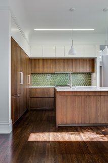 Kitchen - European fumed chestnut cabinetry, featuring quarter-sawn, sequenced veneers and an oiled finish, Miele appliances, Heath tile backsplash, Calacatta countertops, Louis Poulsen pendant lights, Recreated original baseboards, window trim, and picture rail from original 1905 detailing