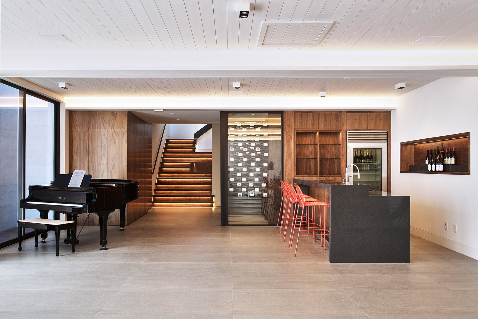 The Great Room - wet bar, wine room, entertainment space   Lyon Residence by Diego Pacheco Design Practice