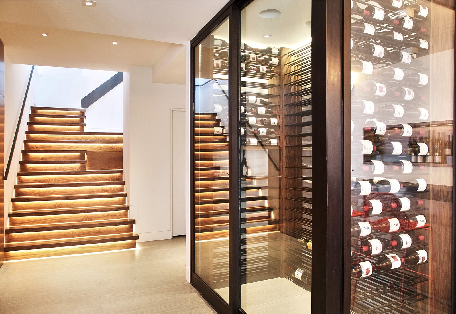 Staircase, Wood Tread, Wood Railing, and Glass Railing Stairs + Wine Room  Lyon Residence by Diego Pacheco Design Practice