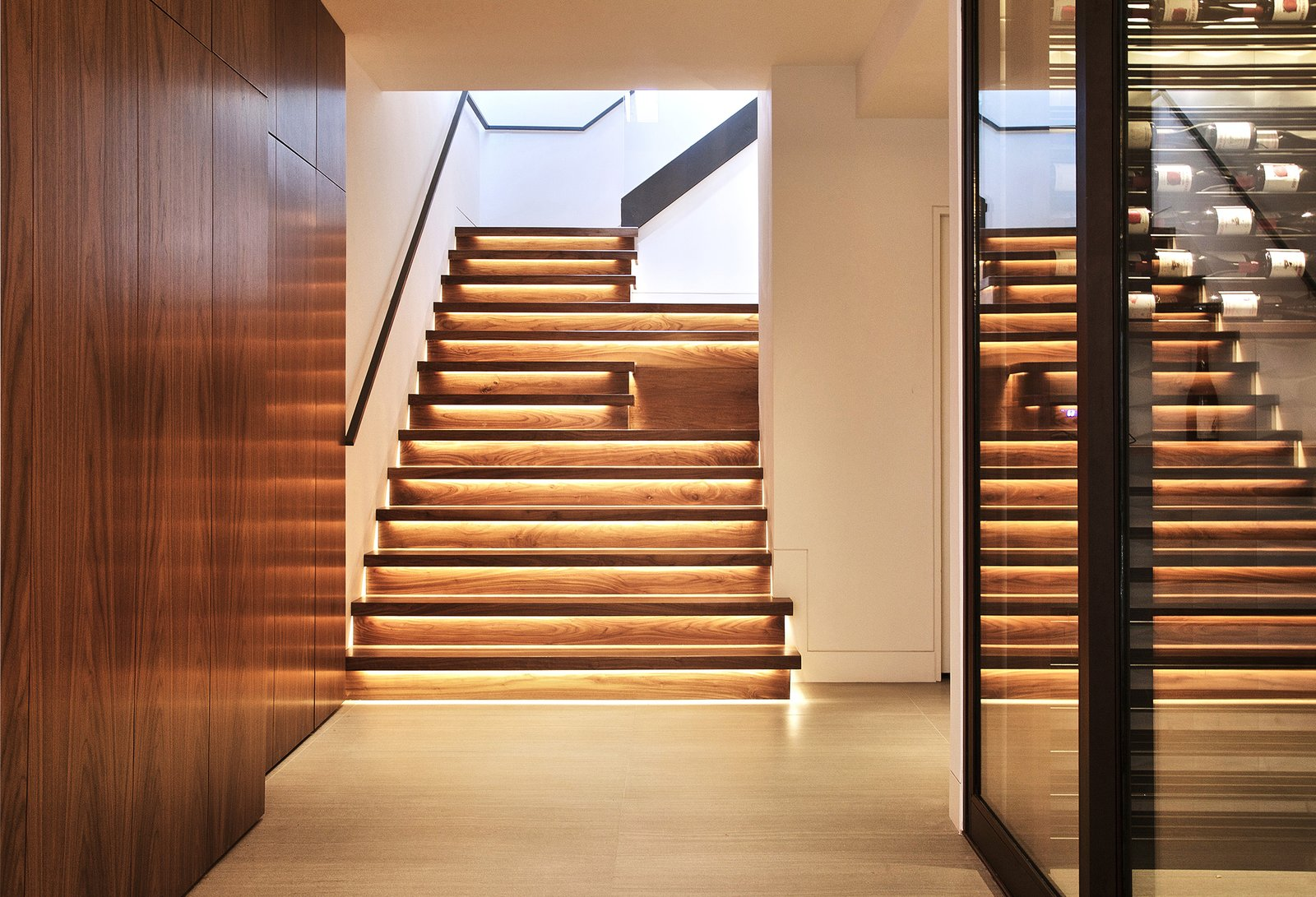 Staircase, Wood Tread, and Wood Railing Cascading Walnut Stairs w/ LED lights  Lyon Residence by Diego Pacheco Design Practice