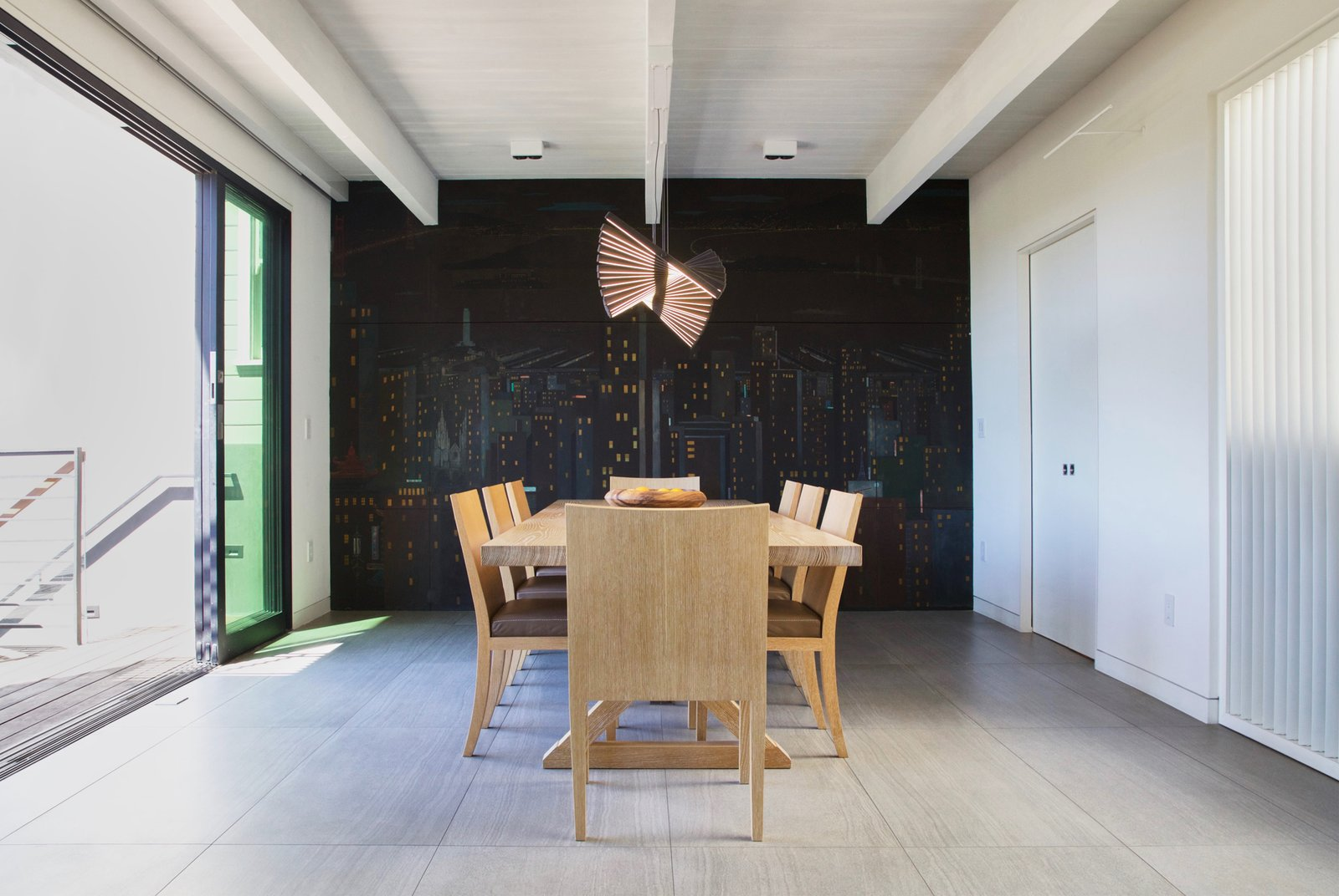 Dining Room, Track Lighting, Table, Chair, Accent Lighting, and Ceramic Tile Floor Dining Room - operable louvers at stair, original Jose Moya del Pino cityscape mural, Vibia Rythm light, Hermés table and chairs, Fleetwood sliding doors to deck  Lyon Residence by Diego Pacheco Design Practice