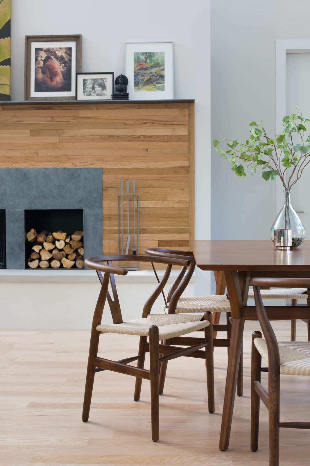 The wood used on the fireplace wall was salvaged from the floor of the old home that the Architect and her husband lived in before eventually deciding to build a new home in its place. It was painstakingly salvaged, sorted, stripped, cut, and re-stained before finding new life as a wall finish.  Photo 4 of 8 in Q&A With an Architect About What it's Like to Design Your Own Home