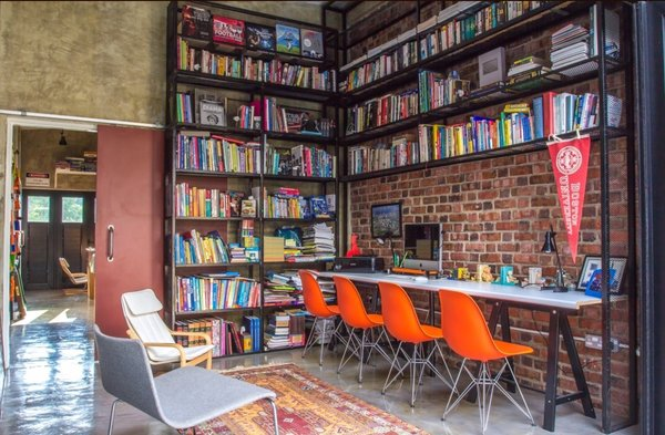 The study with floor to ceiling book shelves double up as internet browsing area and home tuition