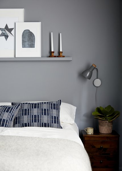 The calming grey colour scheme continues in the guest bedroom. Cushions by Eleanor Pritchard.