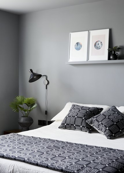 The master bedroom, with calming grey paintwork and welsh blanket and cushions by Melin Tregwynt.