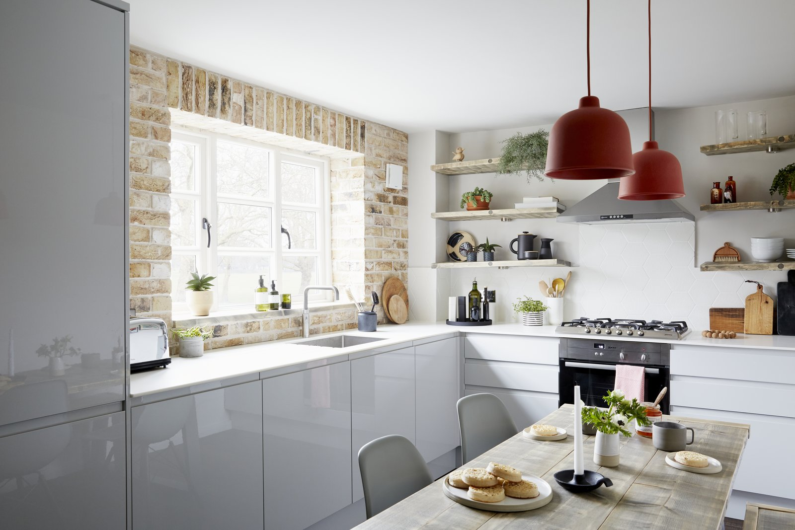 Kitchen, Ceramic Tile Backsplashe, Ceiling Lighting, Colorful Cabinet, and Undermount Sink A brick wall and reclaimed timber shelves add character and warmth against the modern grey kitchen units.  Eames DSW dining chairs and pendant lights by Muuto bring colourful Scandi touches.  Best Photos from Artillery House