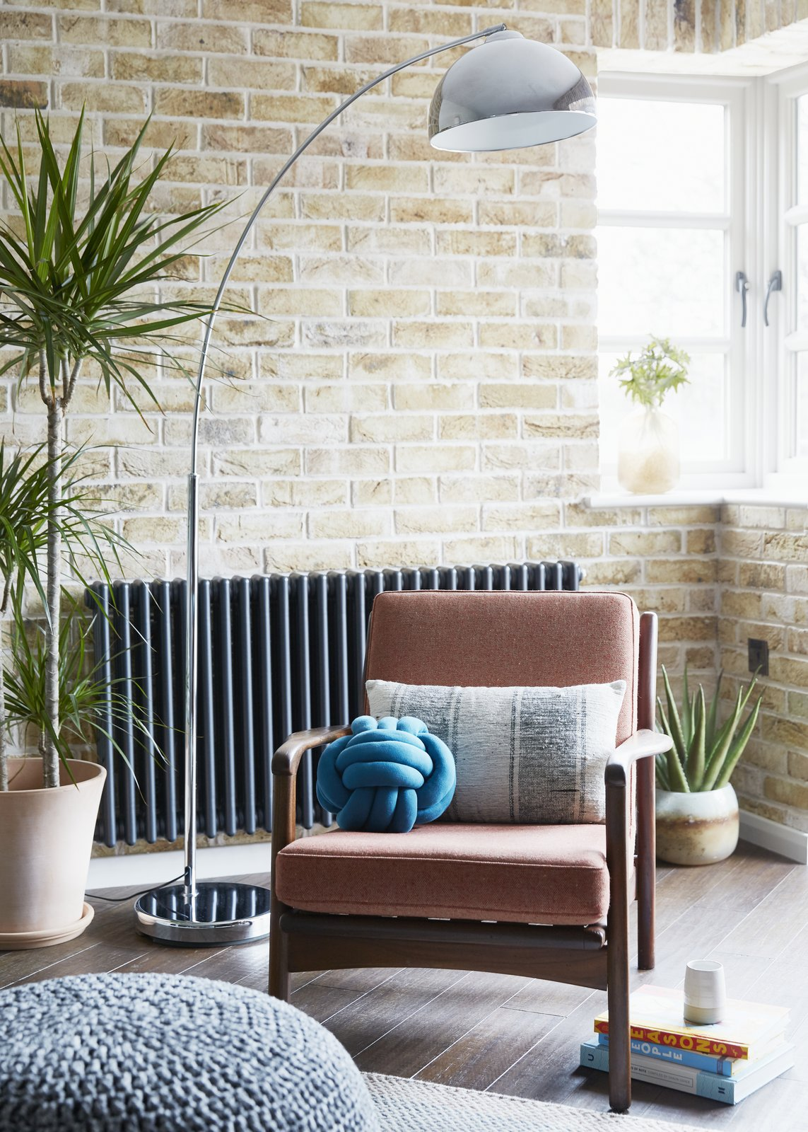 Living, Bamboo, Chair, and Floor A vintage Danish teak armchair sits against a London stocks brick wall.  Best Living Floor Bamboo Photos from Artillery House