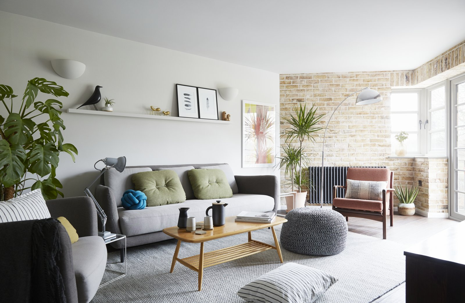 Living, Floor, Sofa, Coffee Tables, Bamboo, Shelves, Table, Lamps, Chair, Rug, and End Tables The light-filled living room, with a London stocks brick wall, vintage mid century furnishings and modern Scandi decorative touches.  Best Living Floor Bamboo Photos from Artillery House