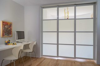 AFTER - Son's study area and activity room separate using 3 frosted glass retractable panels.
