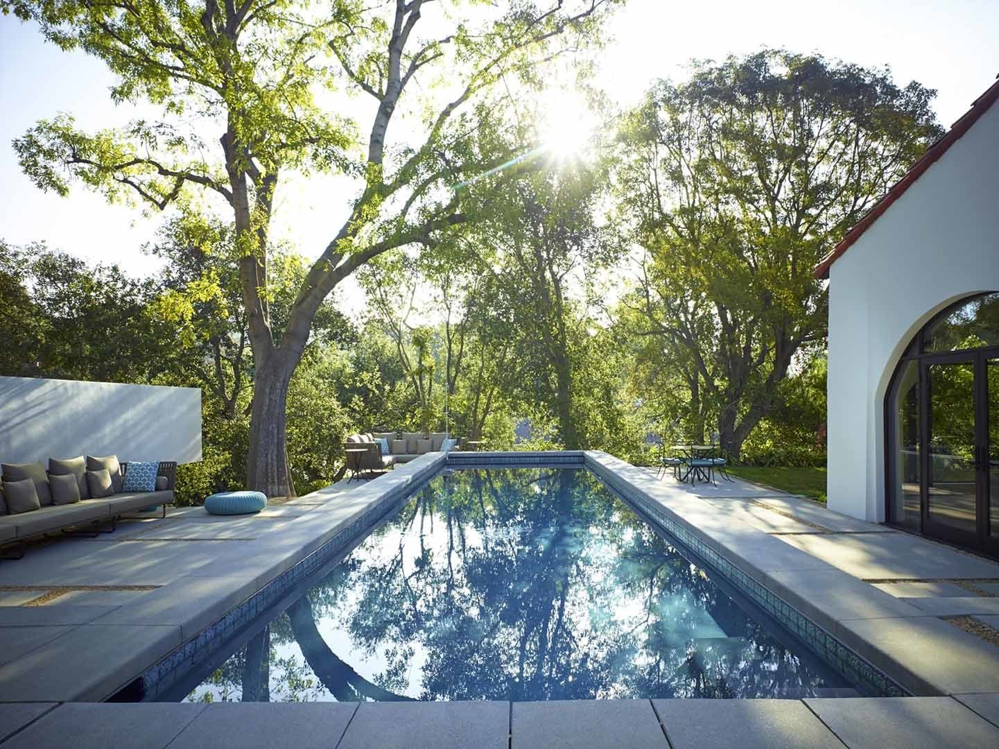 Lined with tiles from the historic Jackling House, designed by George Washington Smith and once owned by Steve Jobs, the pool addition gave reason to further enjoy the southern California climate.  Morgan Phoa Library and Residence