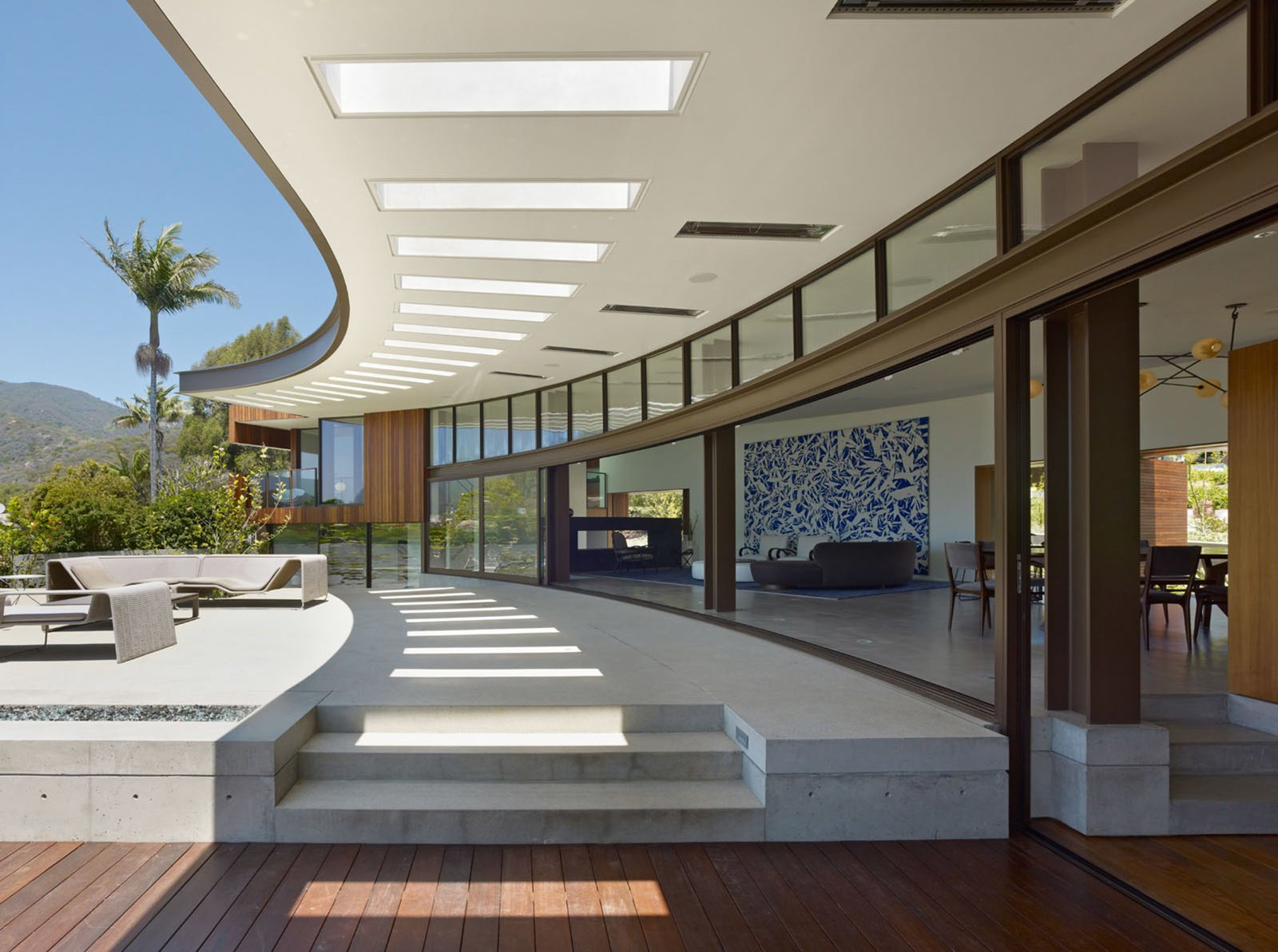 The courtyard side of the house is an exercise in transparency. Sliding glass panels open up the entire house to the outdoors.  Ziering Residence