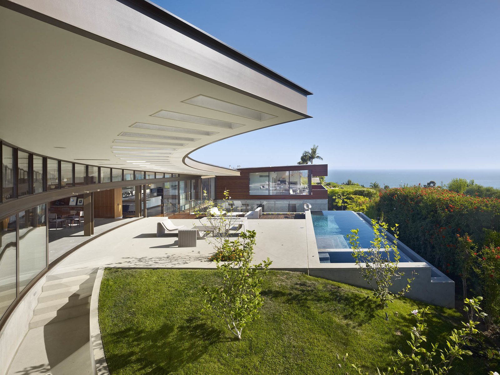 A deep overhang offers an interstitial covered area for al fresco living.  Ziering Residence