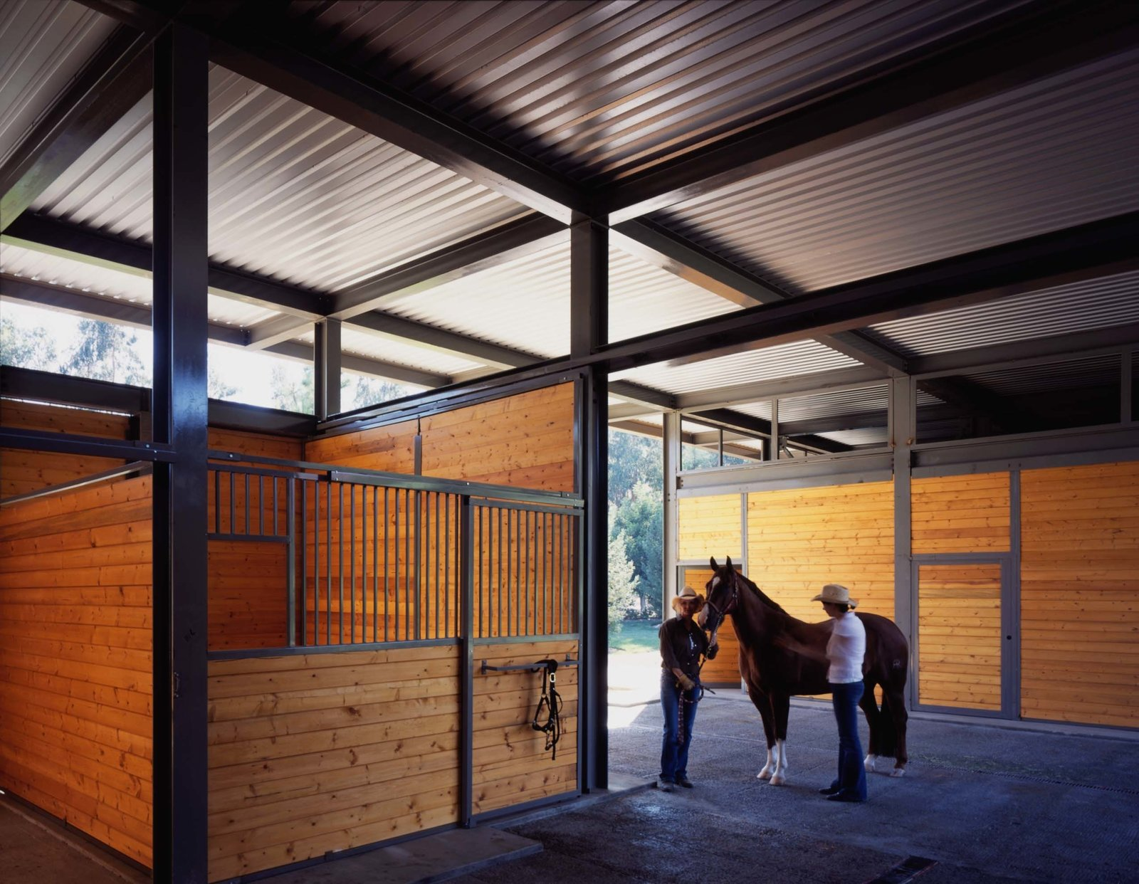The steel structural system is designed based on a simple grid, constructed to the ideal dimensions for a horse stable. Natural ventilation is encouraged via open clearstories, and the large roof overhang protects the cladding from the rain.  Somis Hay Barn