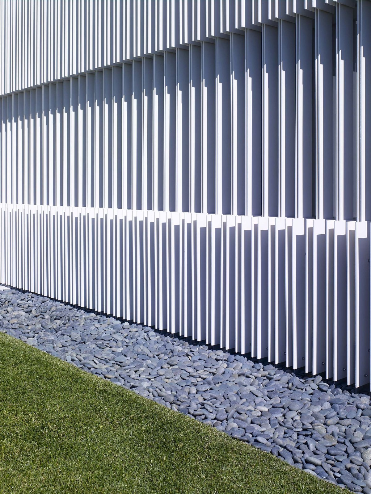 The vertical louvers provide a unique architectural contrast to the building's strong horizontal elements.  Oberfeld Residence