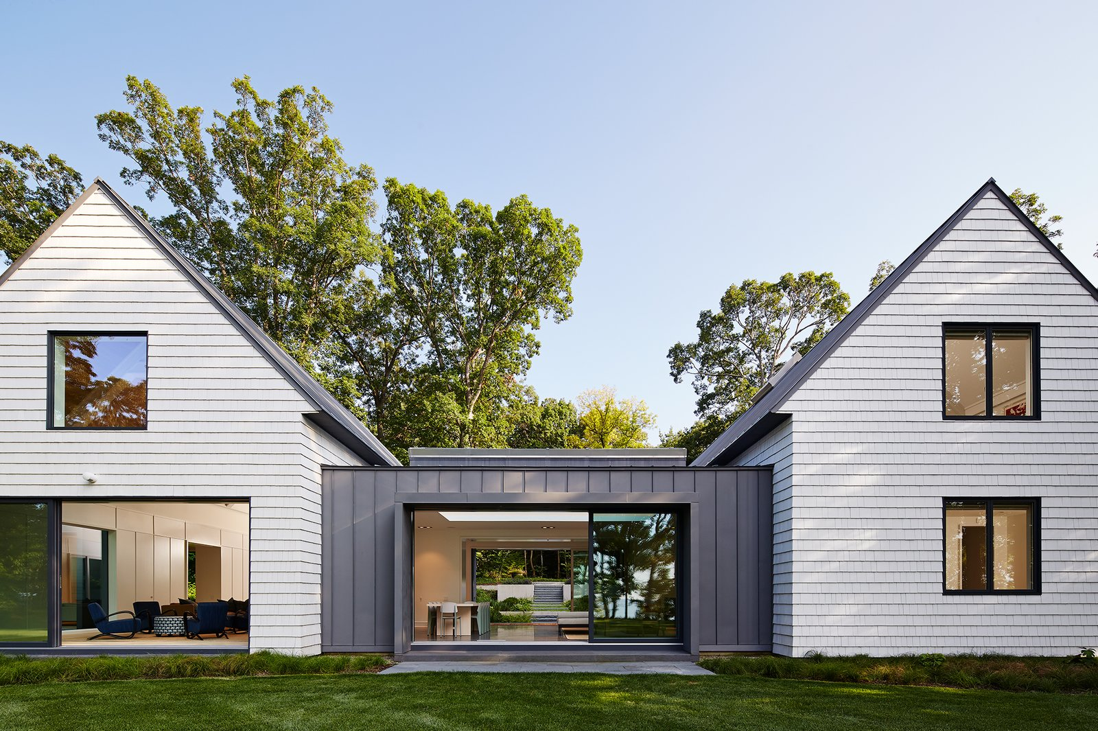 Dining Porch Flanked by Living and Bedroom Volumes  New Buffalo Residence by Booth Hansen
