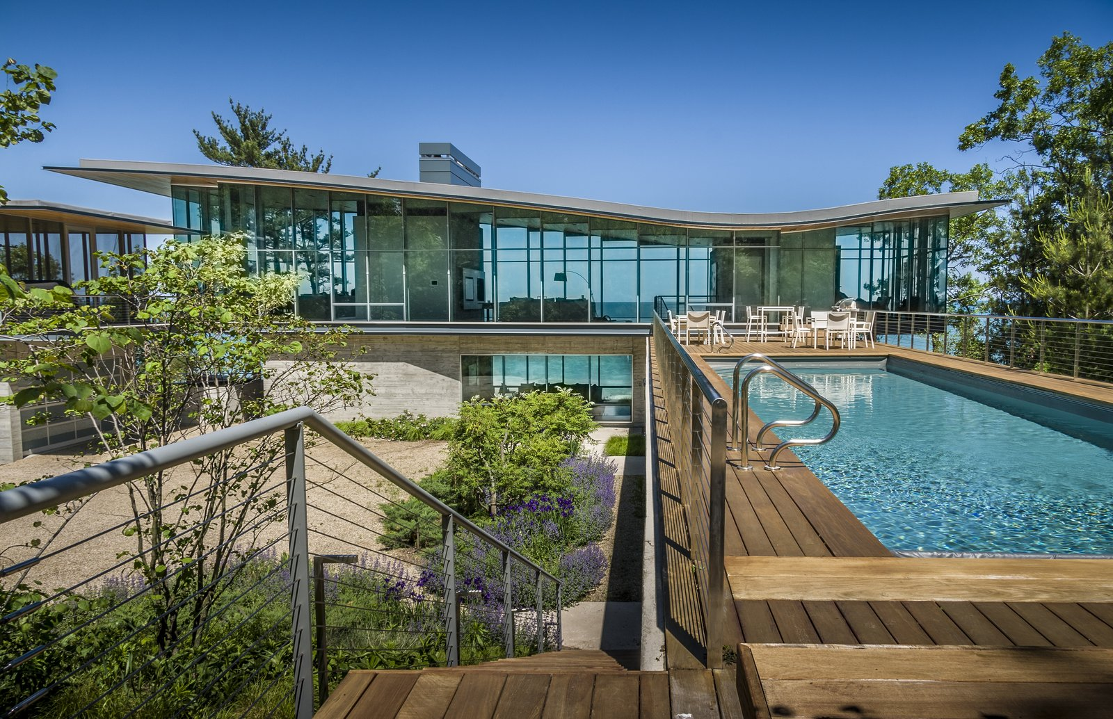 View Towards Lake from Pool Terrace  Beverly Shores Residence by Booth Hansen