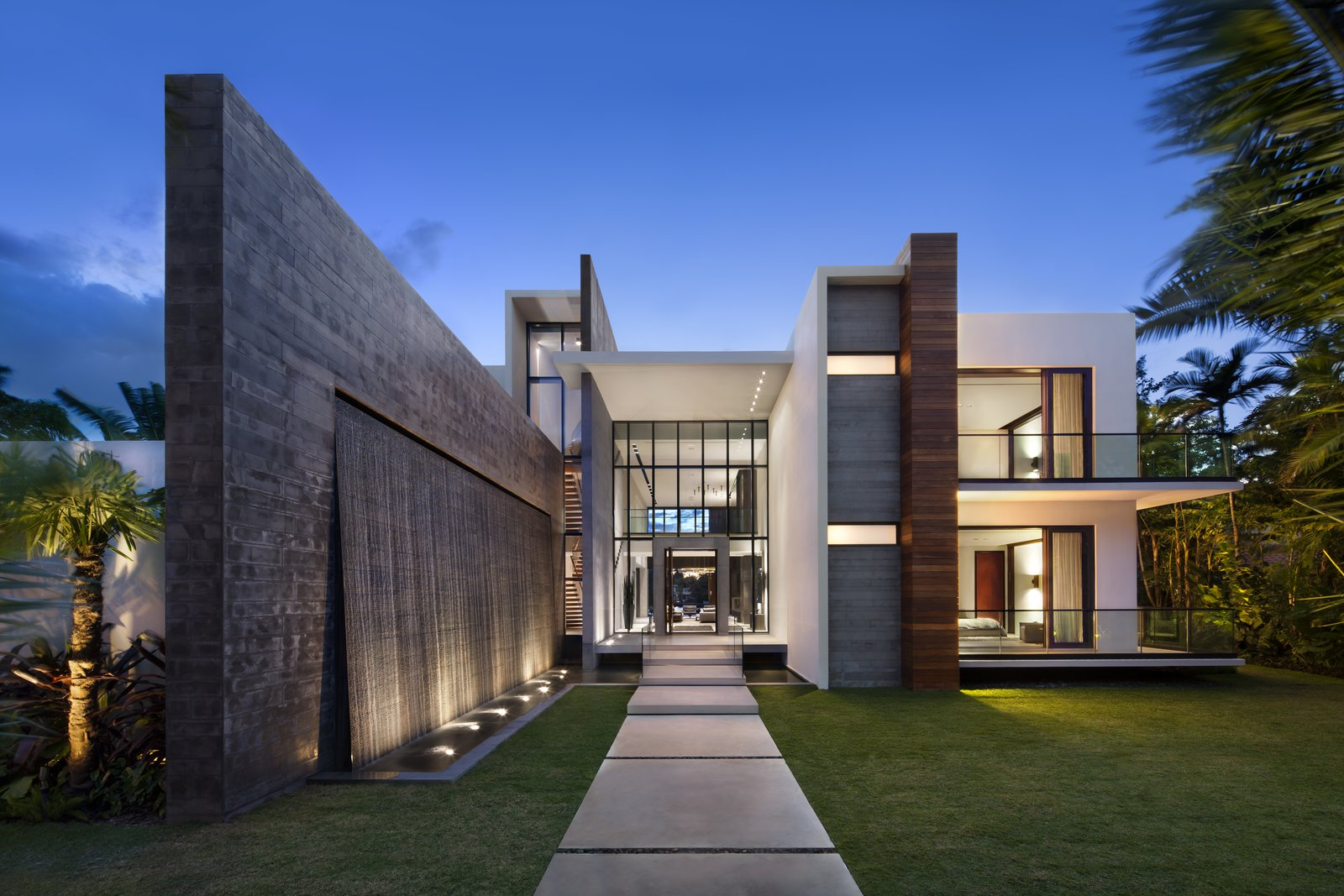 Front entrance featuring cascading water wall  Casa Clara by Choeff Levy Fischman