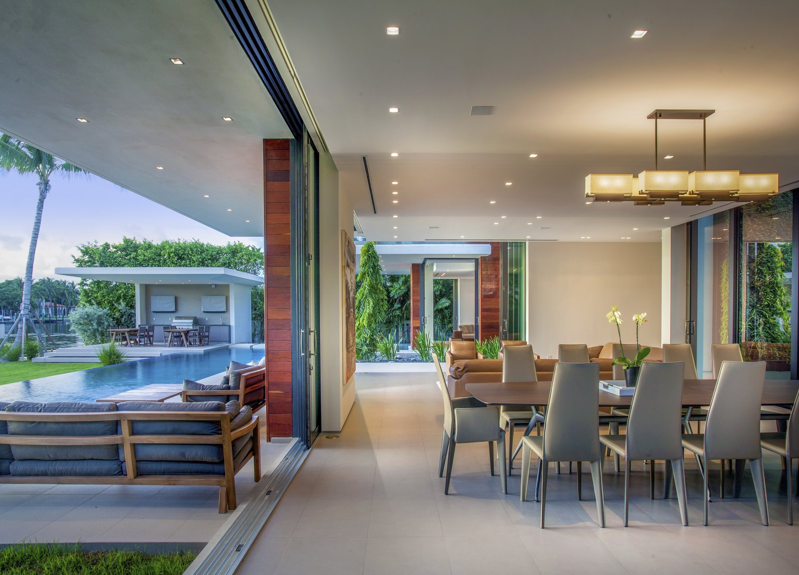Indoor-outdoor living and dining area  Allison Road Residence by Choeff Levy Fischman