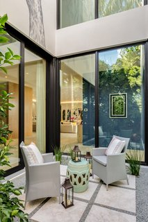 Designed by Choeff Levy Fischman, this home in Miami Beach emphasizes transparency, views, indoor/outdoor living, and entertaining. A critical component of this is an atrium in the center of the residence, which creates an outdoor seating area while still inside the home.