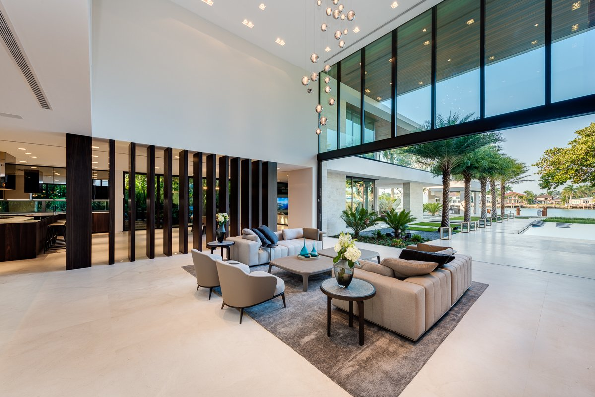 Living, Sofa, End Tables, Coffee Tables, Chair, Ceiling, Recessed, Ribbon, and Limestone Vertical wood elements separate the main living room from the kitchen area, while still emphasizing openness.  Best Living Sofa Limestone Photos from Palm Island Residence