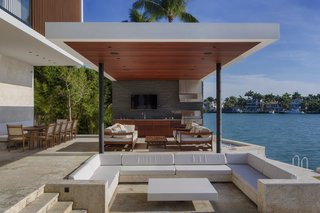 A waterfront conversation pit brings a touch of midcentury glamour to this modern oasis in Miami Beach.