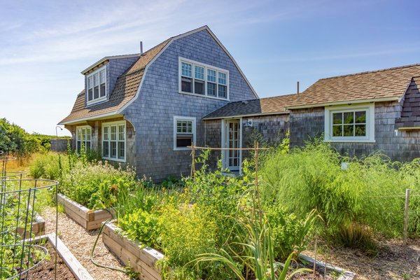 On the sunny south side of the existing rehabilitated 1880 structure, repurposed as a summer guesthouse, is a florishing garden which provides the owners with fresh vegetables, raspberries and blueberries.  Corkin House