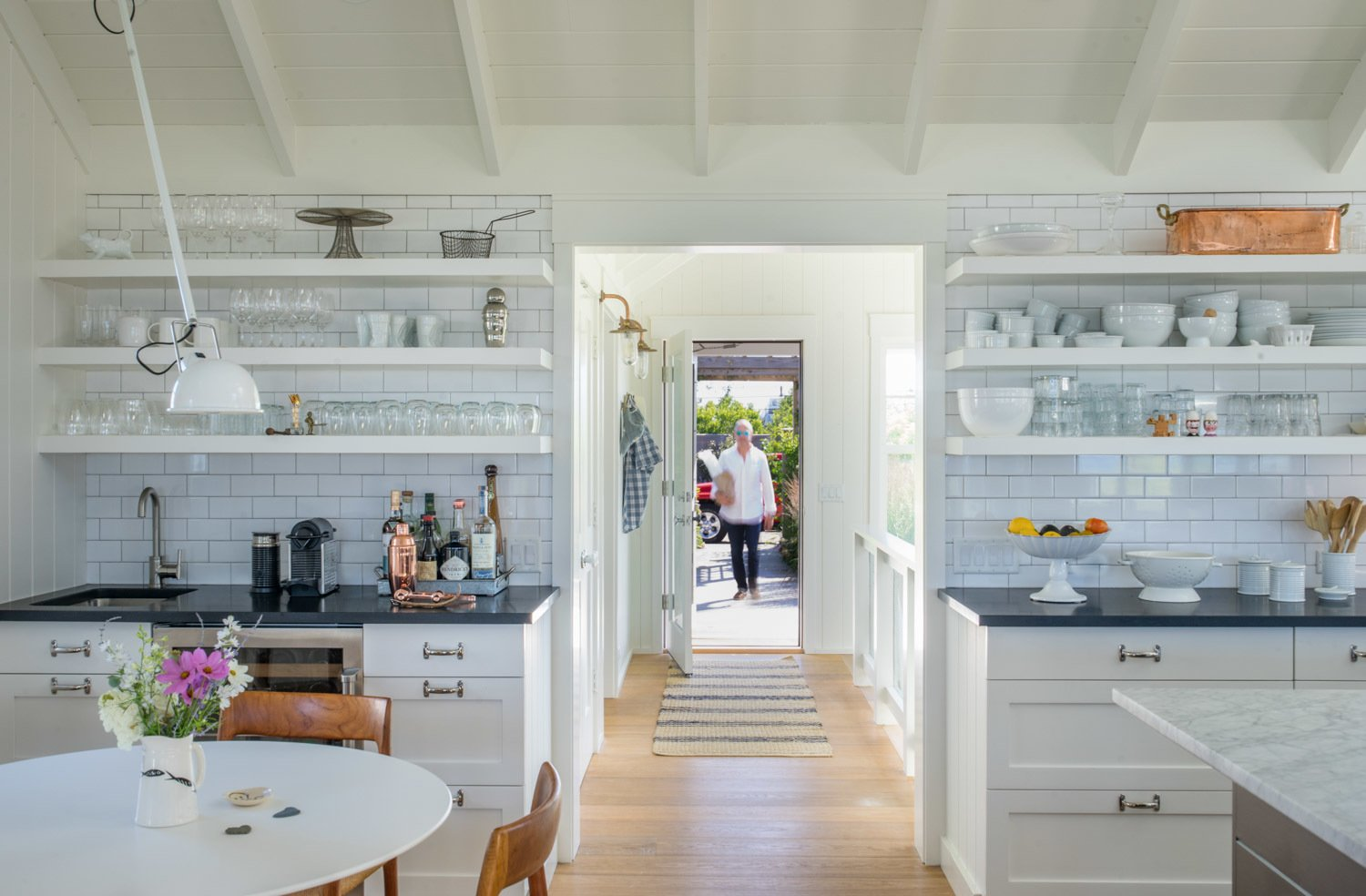 Entry to the main house leads casually onto a simple, minimalist open kitchen featuring a 5' by 12' marble topped island especially handy for mingling guests.. A breakfast/bar alcove tucked away in a corner is available for a quick home grown salad, an unpretentious capucchino, or a cool drink.  Corkin House
