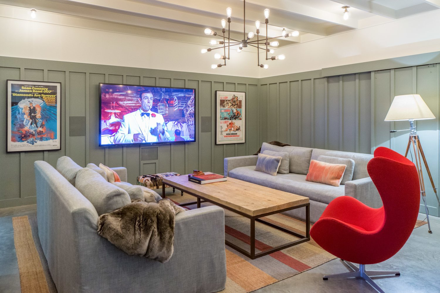 A snug screening room, located on the lower level, has a radiant heated floor. A bar, and a half bath are located conveniently adjacent.  Corkin House